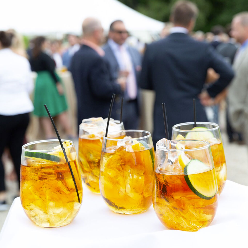 catering vendors for New Hampshire events. glasses of cocktails on a tray with guests out of focus in the background